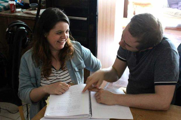 Emma Wall (l) at work on her script