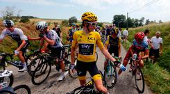 Riders with Britain's Geraint Thomas