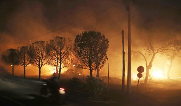 Buildings burn in the town of Mati, east of Athens (AP Photo/Thanassis Stavrakis)