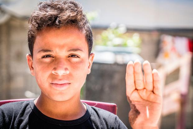 Horror: Pictured in Palestine was 14-year-old Amed Alhalw who told John: