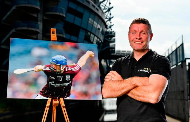 Former Galway star and EirGrid ambassador Damien Hayes outside Croke Park with a picture of himself celebrating a goal in 2010 as part of the GAA 'Moment In Time' campaign. Photo by Sam Barnes/Sportsfile