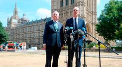 Justice Minister Charlie Flanagan and Tánaiste Simon Coveney during a press conference on College Green in London following a meeting of the British-Irish Intergovernmental Conference. Picture: PA