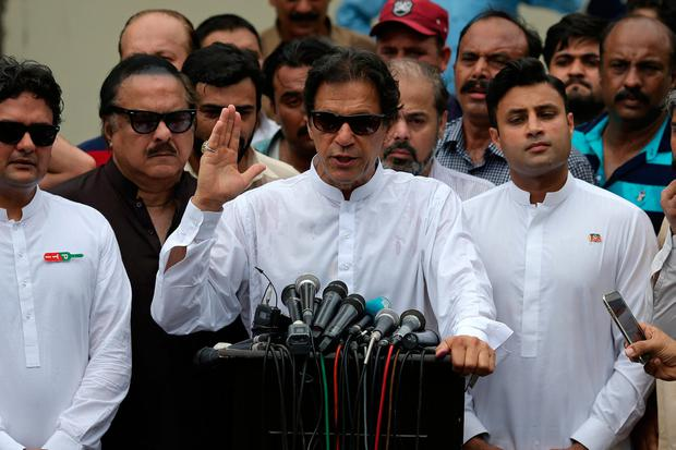 Cricket star-turned-politician Imran Khan after casting his vote in Islamabad, Pakistan. Photo: Reuters