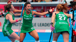 Anna O'Flanagan (second left) celebrates after scoring Ireland's winning goal in their Women's Hockey World Cup Group B clash with India in London
