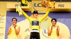 Geraint Thomas celebrates on the podium in the yellow jersey after Stage 18 of the Tour de France. Photo: PA Wire
