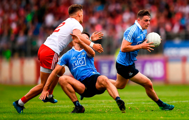 Dublin's Brian Howard, making a break as James McCarthy is knocked over by Tyrone's Michael McKernan last weekend, would be a significant addition to Galway. Photo: Stephen McCarthy/Sportsfile