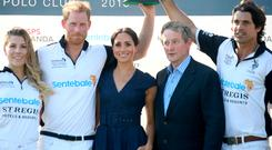 WINDSOR, ENGLAND - JULY 26: (L-R) Ashley van Metre Busch, Prince Harry Duke of Sussex, Meghan Duchess of Sussex, Enda Kenny and Nacho Figuarespose with the Sentebale Polo 2018 trophy after the Sentebale Polo 2018 held at the Royal County of Berkshire Polo Club on July 26, 2018 in Windsor, England. (Photo by Chris Jackson/Getty Images)