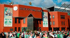 Fans arrive outside the stadium prior to the first leg UEFA Champions League Qualifier match between Celtic and Rosenborg at Celtic Park Stadium on July 25, 2018 in Glasgow, Scotland.