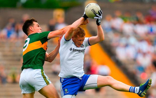 Kieran Hughes of Monaghan in action against Jack Barry of Kerry - Both counties are vying for a place in the All Ireland semi-final