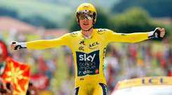 Geraint Thomas, wearing the overall leader's yellow jersey. reacts as he crosses the finish line yesterday during the twentieth stage of the Tour de France. Photo: Photo/Christophe/AP