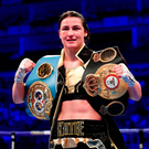 Katie Taylor celebrates with both championship belts following her WBA & IBF World Lightweight Championship bout with Kimberly Connor at The O2 Arena in London, England.