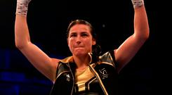 Katie Taylor celebrates victory over Kimberly Connor after the WBA and IBF World Lightweight Championship title fight between Katie Taylor and Kimberly Connor at The O2 Arena on July 28, 2018 in London, England.