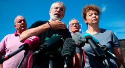 Former Sinn Fein president Gerry Adams at a press conference alongside prominent Sinn Fein members (from left) Bobby Storey, Gerry Kelly, and Caral Ni Chuilin following an explosives device attack on his and Bobby Storey's homes. Photo: PA Wire