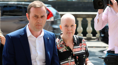 ORDEAL: Ruth Morrissey and her husband Paul outside the High Court where she is suing the HSE and the laboratories that she alleges misinterpreted two smear tests. Pic: Collins Courts