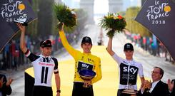 Team Sky rider Geraint Thomas of Britain, wearing the overall leader's yellow jersey, Team Sunweb rider Tom Dumoulin of the Netherlands and Team Sky rider Chris Froome of Britain celebrate on the podium.