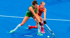 Deirdre Duke of Ireland holds off the challenge of Giselle Ansley of England during the Women's Hockey World Cup Finals Group B match between England and Ireland at Lee Valley Hockey Centre, QE Olympic Park in London, England.