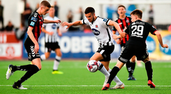 Michael Duffy of Dundalk in action against Daniel Kelly and Andy Lyons of Bohemians during the SSE Airtricity League Premier Division match between Dundalk and Bohemians at Oriel Park in Dundalk, Co Louth.