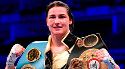 Katie proudly dispaying her belts. Photo: Sportsfile