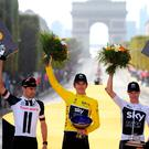 Team Sky rider Geraint Thomas of Britain, wearing the overall leader's yellow jersey, Team Sunweb rider Tom Dumoulin of the Netherlands and Team Sky rider Chris Froome of Britain celebrate on the podium. Photo: Reuters