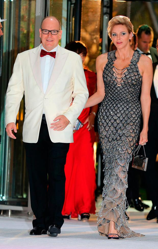 Prince Albert II of Monaco (L) and Princess Charlene of Monaco arrive to attend the 70th annual Red Cross Gala at the Monte-Carlo Sporting Club on July 27, 2018 in Monaco