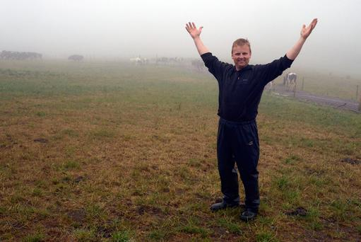 Dairy Farmer Patrick Murphy celebrates the arrival of rain at his dairy farm at Timoleague, West Cork. Picture Denis Boyle