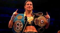 Katie Taylor celebrates victory over Kimberly Connor