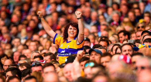 A Clare supporter celebrates a late point during the GAA Hurling All-Ireland Senior Championship semi-final match between Galway and Clare at Croke Park in Dublin. Photo by David Fitzgerald/Sportsfile