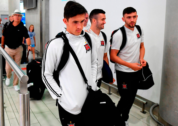 Dundalk's Jamie McGrath, left, Michael Duffy, centre, and Dean Jarvis arrive in Larnaca International Airport in Cyprus last night. Photo: Stephen McCarthy/Sportsfile