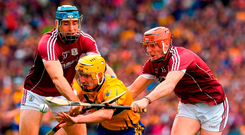 Clare sweeper Colm Galvin in action against Conor Whelan, right, and Conor Cooney of Galway at Croke Park on Saturday. Photo: Ray McManus/Sportsfile