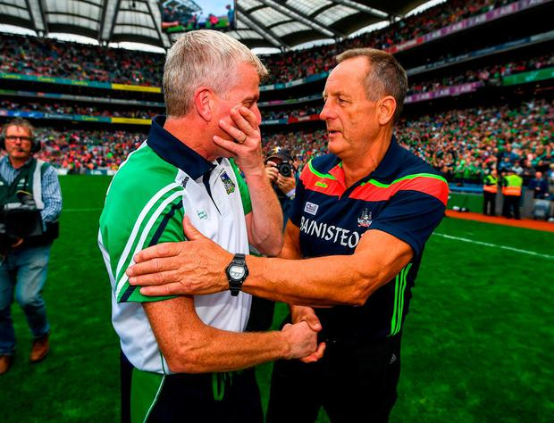Cork's John Meyler, with Limerick boss (left), will be frustrated his side exited the Championship despite not losing a game in regulation time. Photo: Stephen McCarthy/Sportsfile