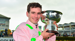 31 July 2018; Jockey Danny Mullins celebrates with the trophy after winning the Colm Quinn BMW Mile Handicap on Riven Light during the Galway Races Summer Festival 2018, in Ballybrit, Galway. Photo by Seb Daly/Sportsfile