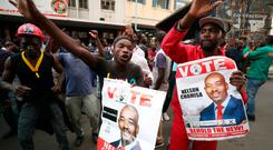 Supporters of the opposition Movement for Democratic Change party (MDC) of Nelson Chamisa, sing and dance in the street outside the party's headquarters following general elections in Zimbabwe. Photo: Mike Hutchings/Reuters