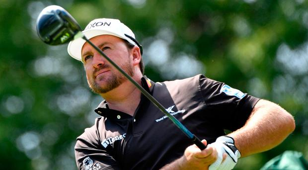 Graeme McDowell and partner Emiliano Grillo hold a three-shot lead in Florida