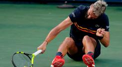 Benoit Paire of France smashes his tennis racket after loosing to Marcos Baghdatis of Cyprus during the first round of the Citi Open tennis tournament, Tuesday, July 31, 2018, in Washington. Baghdatis 6-3, 3-6, 6-2. (AP Photo/Carolyn Kaster)