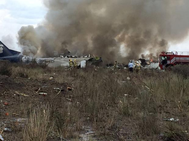 Rescue personnel work at the site where an Aeromexico-operated Embraer passenger jet crashed in Mexico's northern state of Durango, July 31, 2018, in this picture obtained from social media. Proteccion Civil Durango/via REUTERS THIS IMAGE HAS BEEN SUPPLIED BY A THIRD PARTY. MANDATORY CREDIT. NO RESALES. NO ARCHIVES.