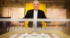 Archbishop of Dublin Diarmuid Martin with a model of the papal altar at the new exhibition in the Phoenix Park Visitor centre. Photo: Gerry Mooney