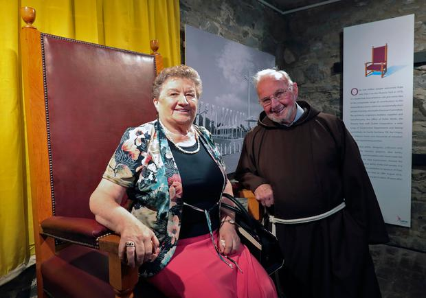 Eithne Merrins, finance officer with Dublin Archdiocese in 1979, and Brother Kevin with the papal chair used by John Paul II. Photo: Collins