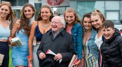 President Michael D Higgins with racegoers at the Galway Festival. Photo: Mark Condren