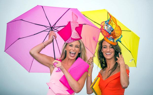 Sisters Gabrielle and Barbara Dunne from Galway don't let the rain spoil their fun. Photo: Mark Condren
