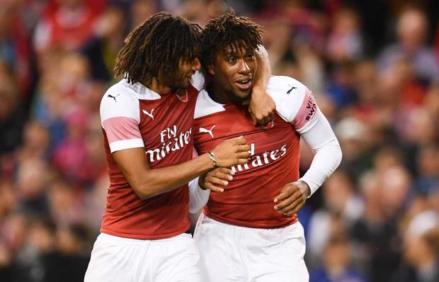 Alex Iwobi of Arsenal, right, celebrates with Mohamed Elneny and after scoring the winning penalty during the International Champions Cup match between Arsenal and Chelsea at the Aviva Stadium in Dublin. Photo by Sam Barnes/Sportsfile