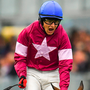Against the odds: Jockey Mark Enright celebrates as he crosses the line to win the the Tote.com Galway Plate Handicap Steeplechase on Clarcam at Ballybrit yesterday