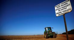 A 'No entry sign' is seen at an entrance of a farm outside Witbank, Mpumalanga province, South Africa July 13, 2018. Picture taken July 13, 2018. REUTERS/Siphiwe Sibeko