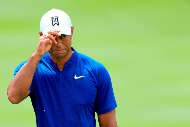 Tiger Woods reacts after making birdie on the 18th green yesterday. Photo: Sam Greenwood/Getty Images