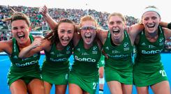 Nicola Evans, Yvonne O'Byrne, Zoe Wilson, Kathryn Mullan and Hannah Matthews celebrate after Ireland's victory over India in the Women's Hockey World Cup quarter-final. Photo: Christopher Lee/Getty Images