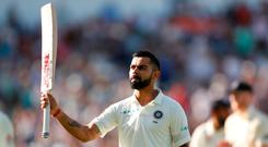 India's Virat Kohli salutes the fans as he walks off the pitch after losing his wicket. Photo: Action Images via Reuters/Andrew Boyers