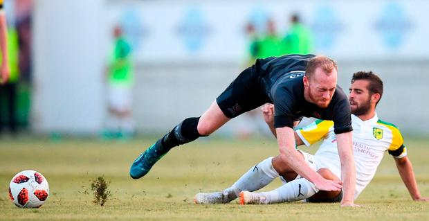 Dundalk's Chris Shields is upended by Larnaca's Hector Hevel. Photo: Stephen McCarthy/Sportsfile