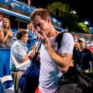 An emotional Andy Murray, of Britain, steps off court after defeating Marius Copil