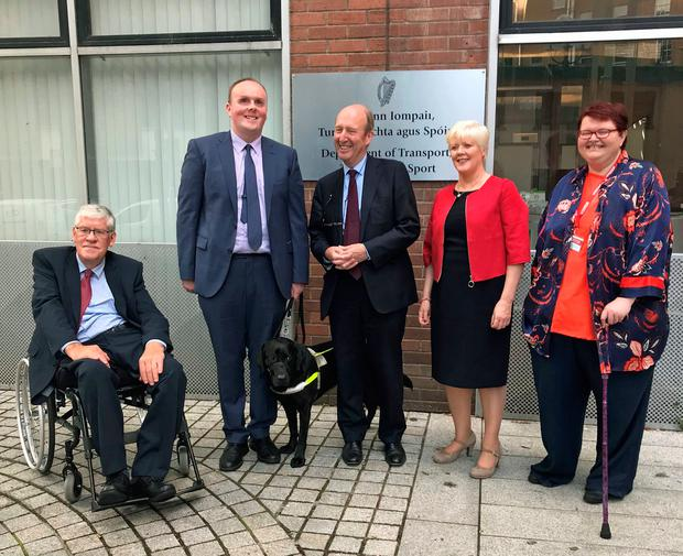 Transport Minister Shane Ross (centre) with (left to right) Liam O'Rourke, Kevin Kelly with guide dog Miles, Elaine Howley and Suzy Byrne Photo credit: Cate McCurry/PA Wire