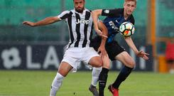 Ryan Nolan (R) competes with Marco Olivieri (L) of Juventus during a Serie A Under-19 game