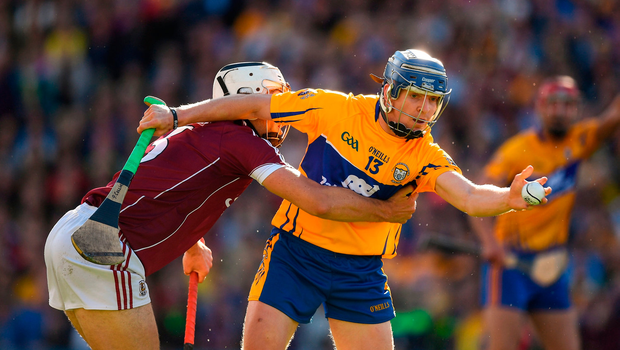 Podge Collins is tackled by Daithi Burke of Galway during last Saturday's draw in Croke Park – the Clare forward is likely to be shadowed closely by Adrian Tuohy in tomorrow's replay. Photo by Ray McManus/Sportsfile